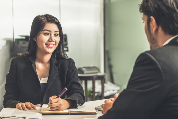 Woman interviewing a job candidate.