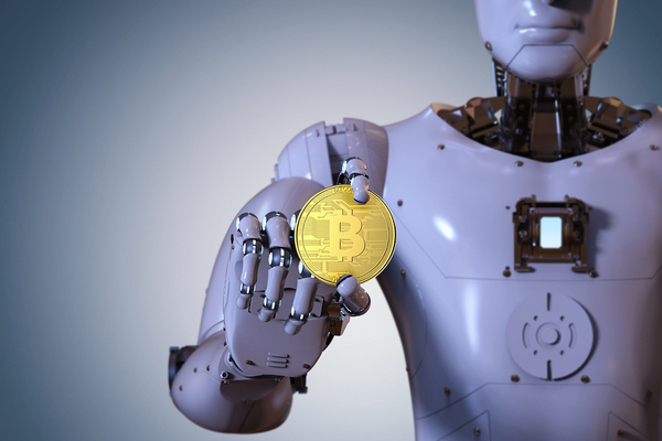 Robot holding a gold coin with bitcoin symbol.