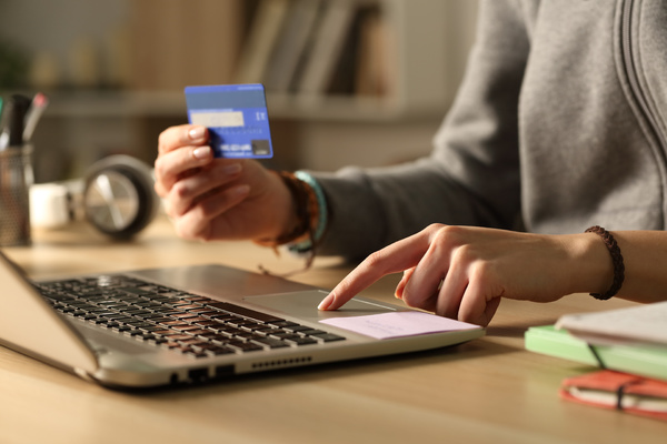 Shopping online with a credit card.