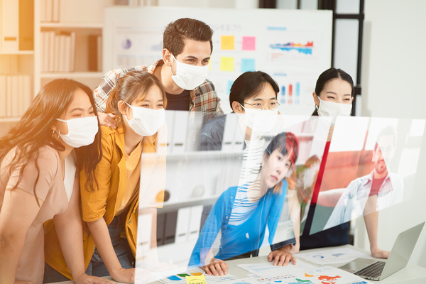 Group of colleagues wearing face masks.