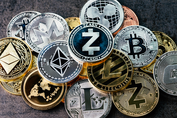 Coins labeled with cryptocurrency icons.