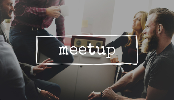 Group of people participating in a meetup.