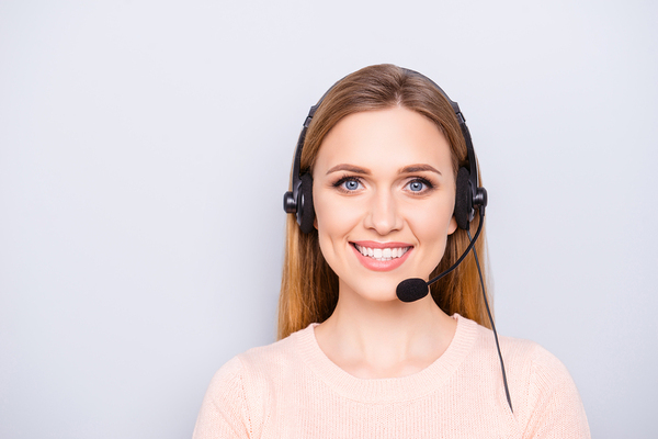 Woman wearing a headset smiling.