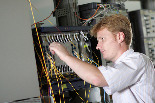 Technician working with computer hardware.