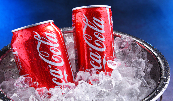 Coca-Cola cans in an ice bucket.