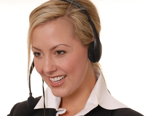 Woman talking on the phone with a headset.