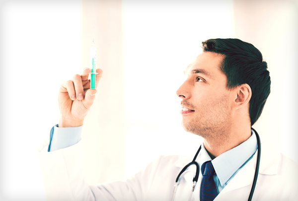 Physician with a syringe.