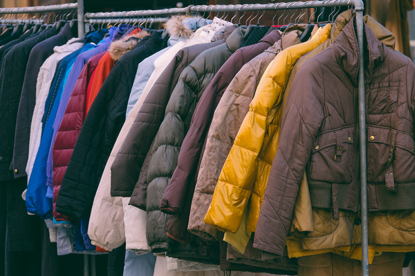 Coats hanging on a rack.