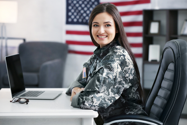 woman in the military in uniform at her desk