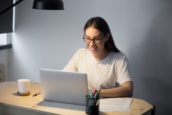 Woman working on her laptop computer.