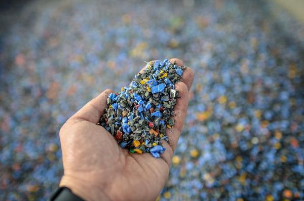 Plastic broken down into small bits.