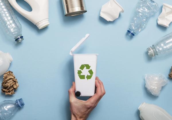 Recycling symbol on a bin.