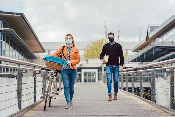 Couple walking on a walkway.