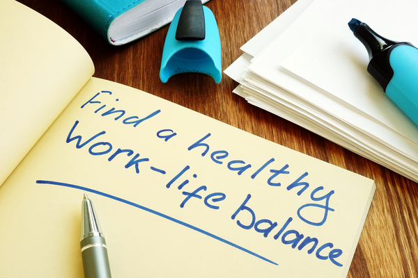 """Notebook with the words """"finding a healthy work-life balance""""."""