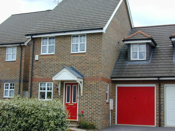 HHouse with bright red garage door