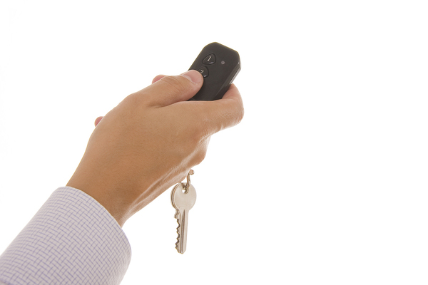 HHand holding garage door remote