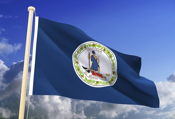 Virginia flag flying with blue sky in the background