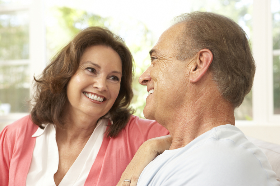 Couple smiling at each other.