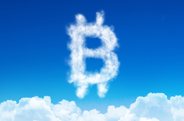 Bitcoin symbol shaped by clouds.