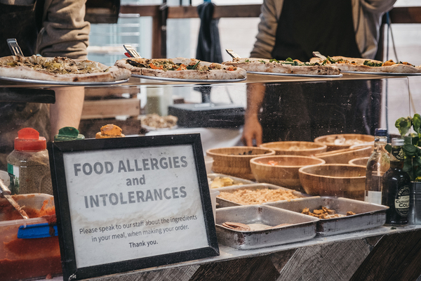 Food shop with a sign labeled Food allergies and intolerances.
