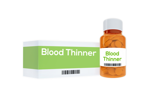 Pill bottle and box with the label blood thinner.