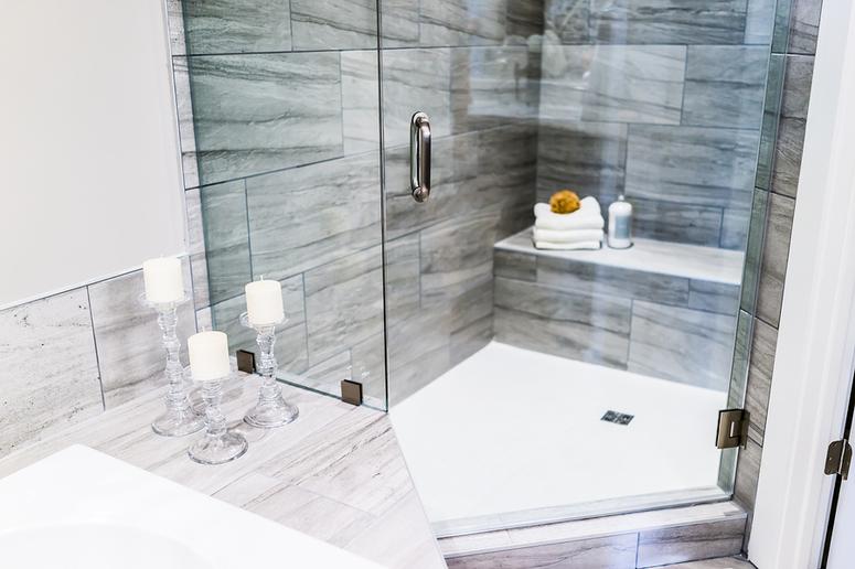 Tile bathroom with glass shower door.