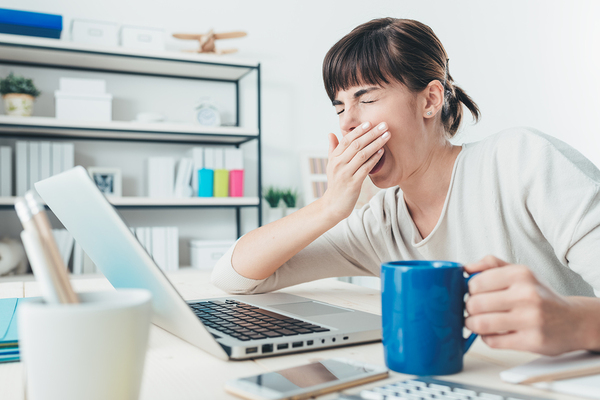 Female business blogger yawning