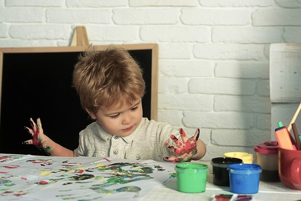 Child finger painting.
