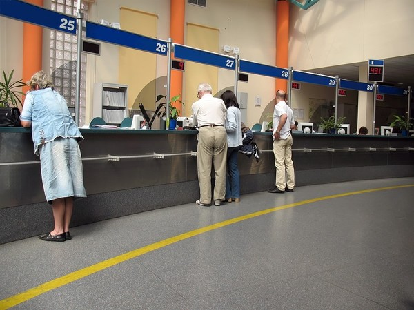 People waiting at counters to be served.