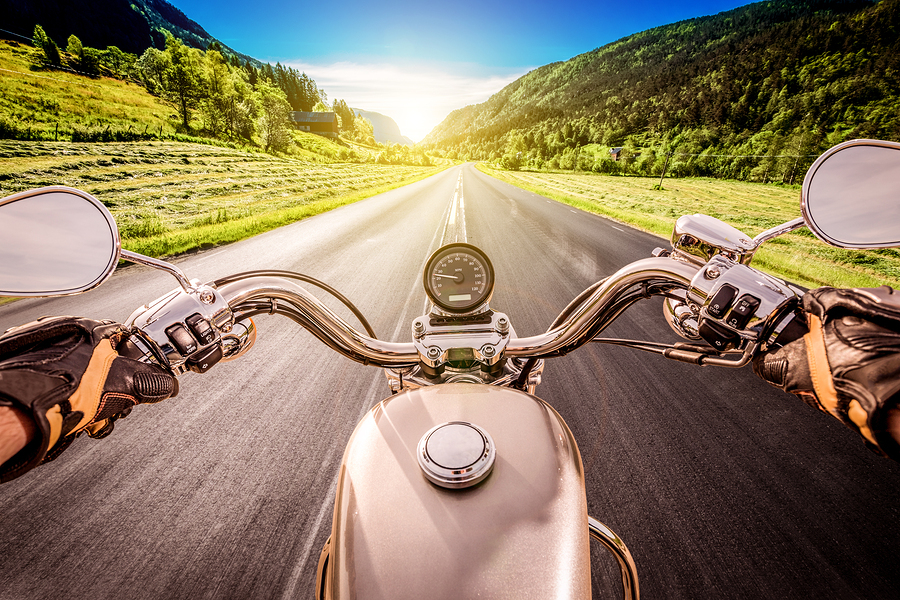 Motorcycle Insurance in California - Motorcycle Riding down the road fast