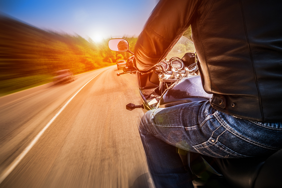 CA Motorcycle Insurance - riding down the road fast