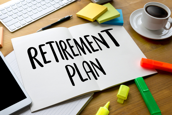 book on a desk, opened, saying retirement plan