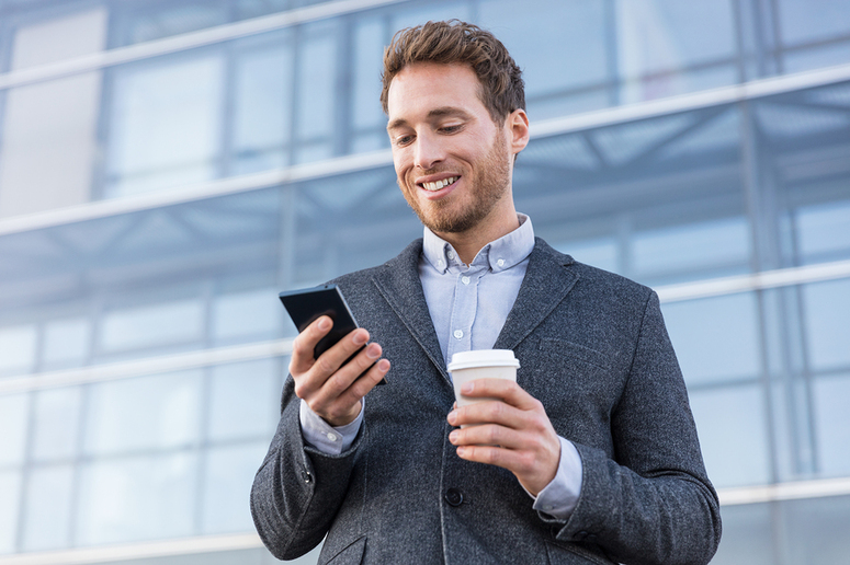 Real estate agent looking at his mobile phone