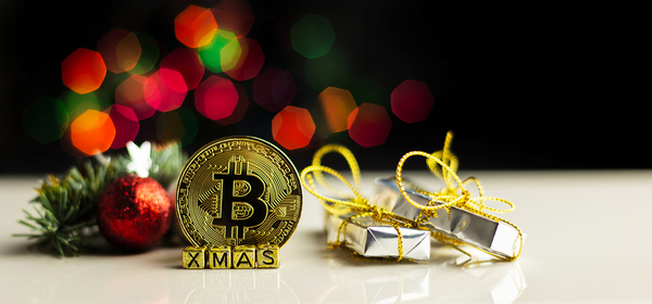 Gold coin with a bitcoin symbol and holiday presents.
