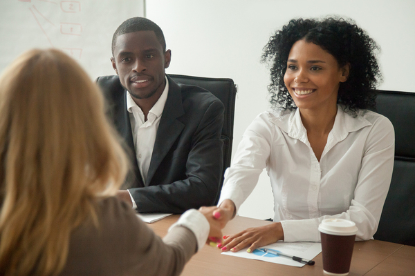 Two hiring managers interviewing a candidate.