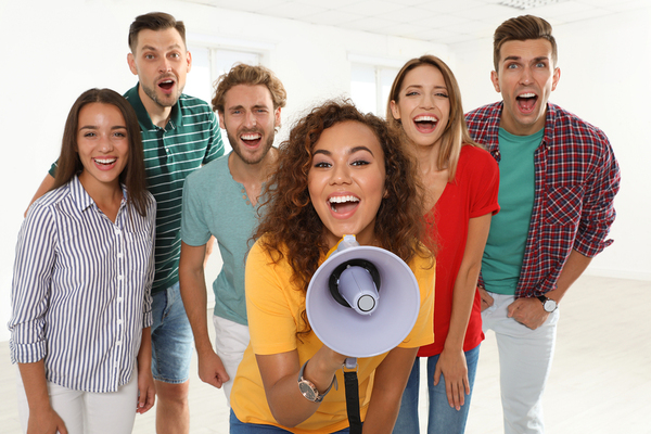 Group of people smiling.