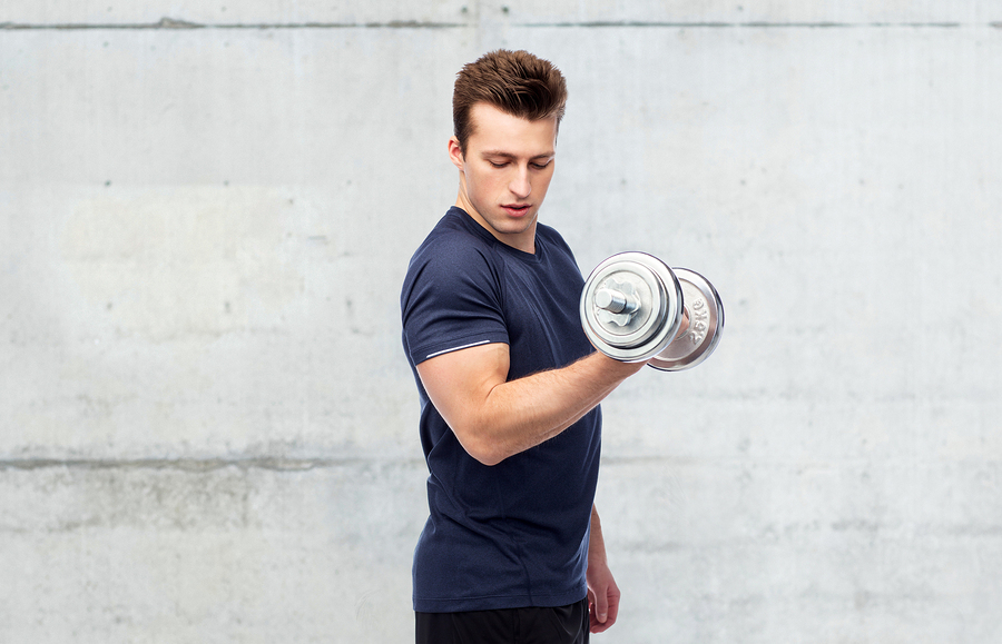 Man lifting a dumbbell with his right arm.