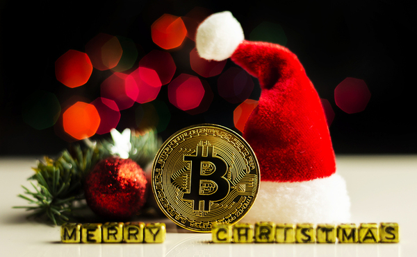 Merry Christmas sign and gold coin with a bitcoin symbol.