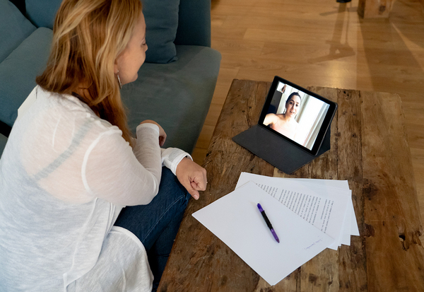 Woman having a video conference using her tablet.