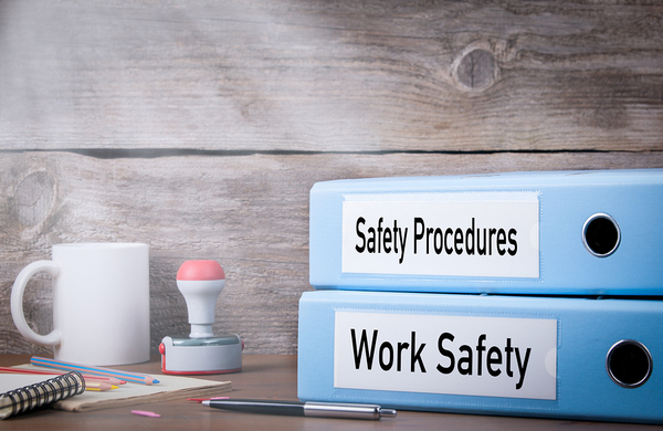 """Two binders with labels """"safety procedures"""" and """"work safety"""""""