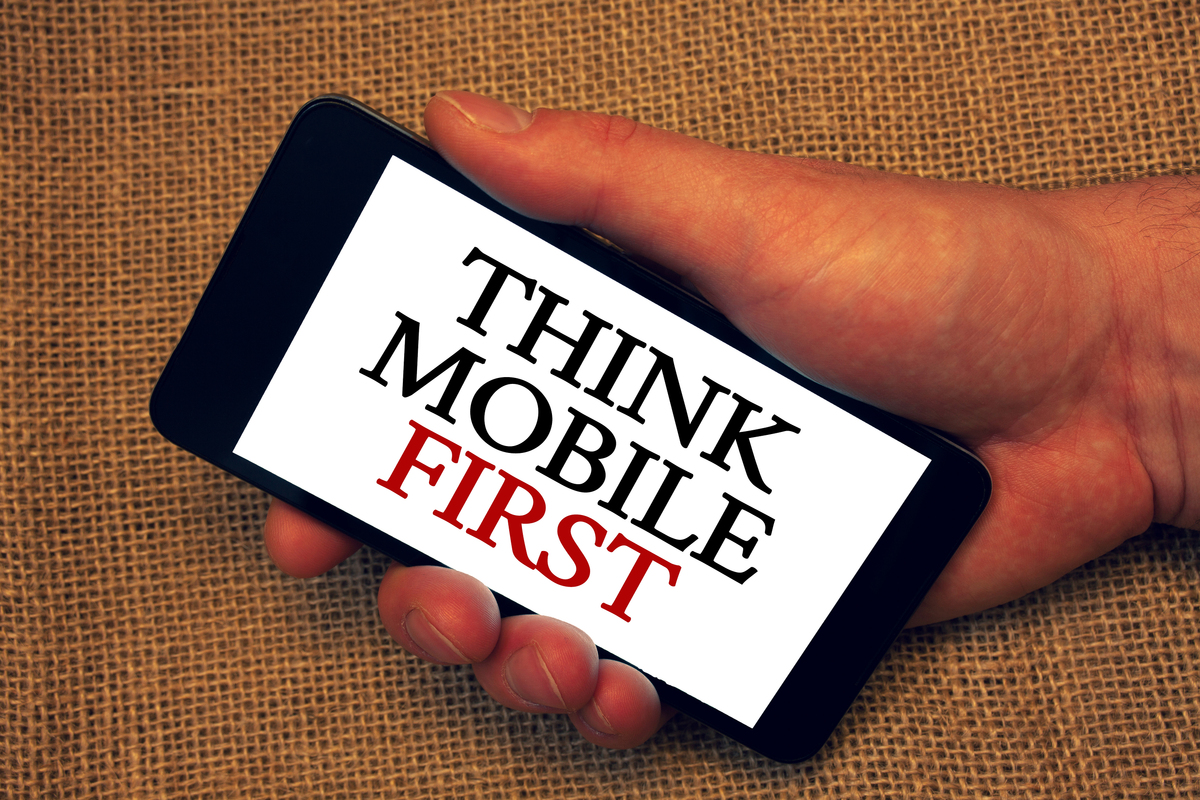 Think mobile first displayed on a mobile phone.