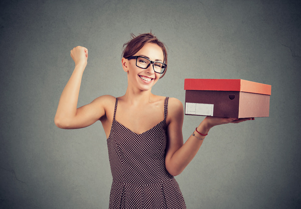 Woman holding a package.