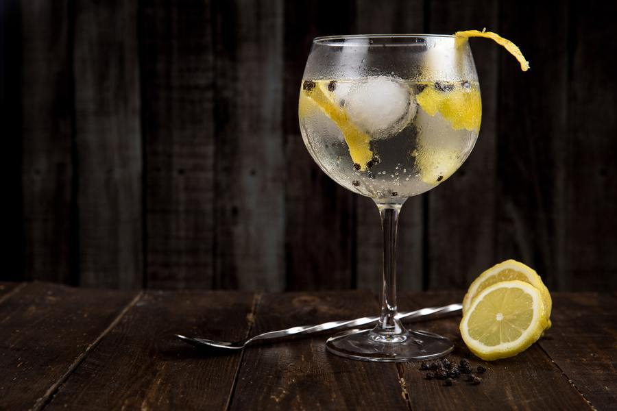 Alcoholic drink with lemon.