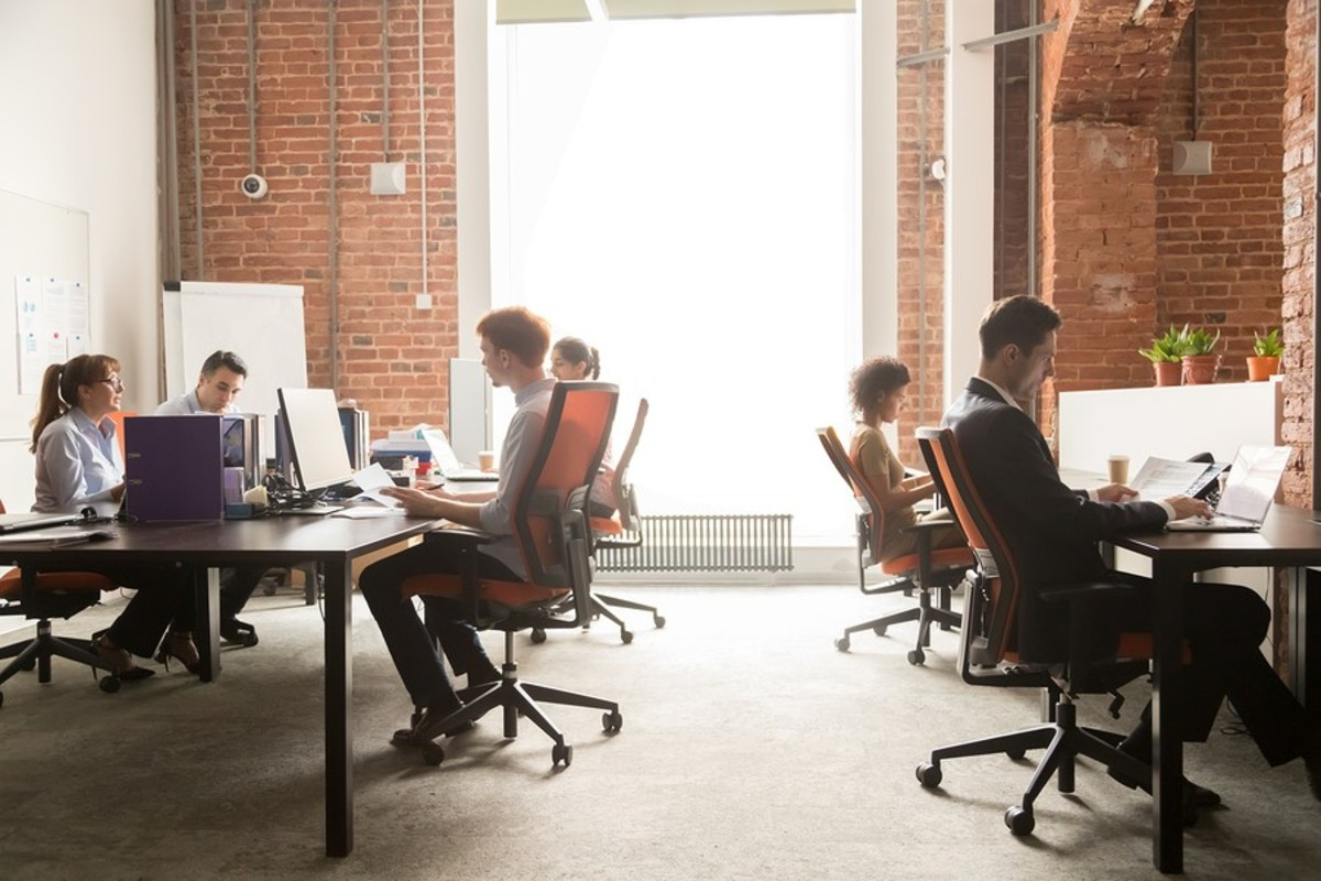 Open Coworking space with tables and chairs.