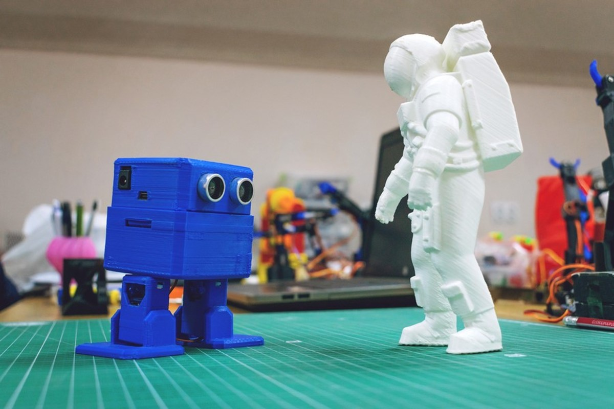 Miniature robot and astronaut.