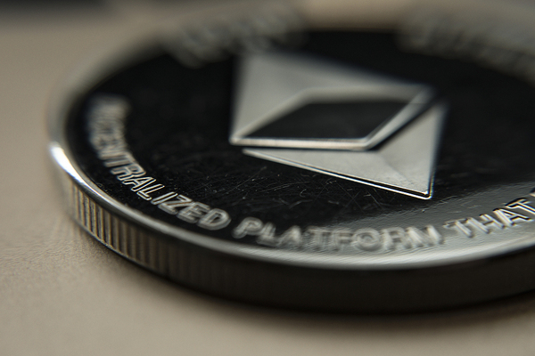 Silver coin with etherum logo.