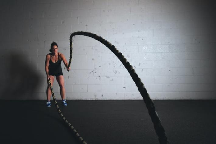 Exercising with ropes.