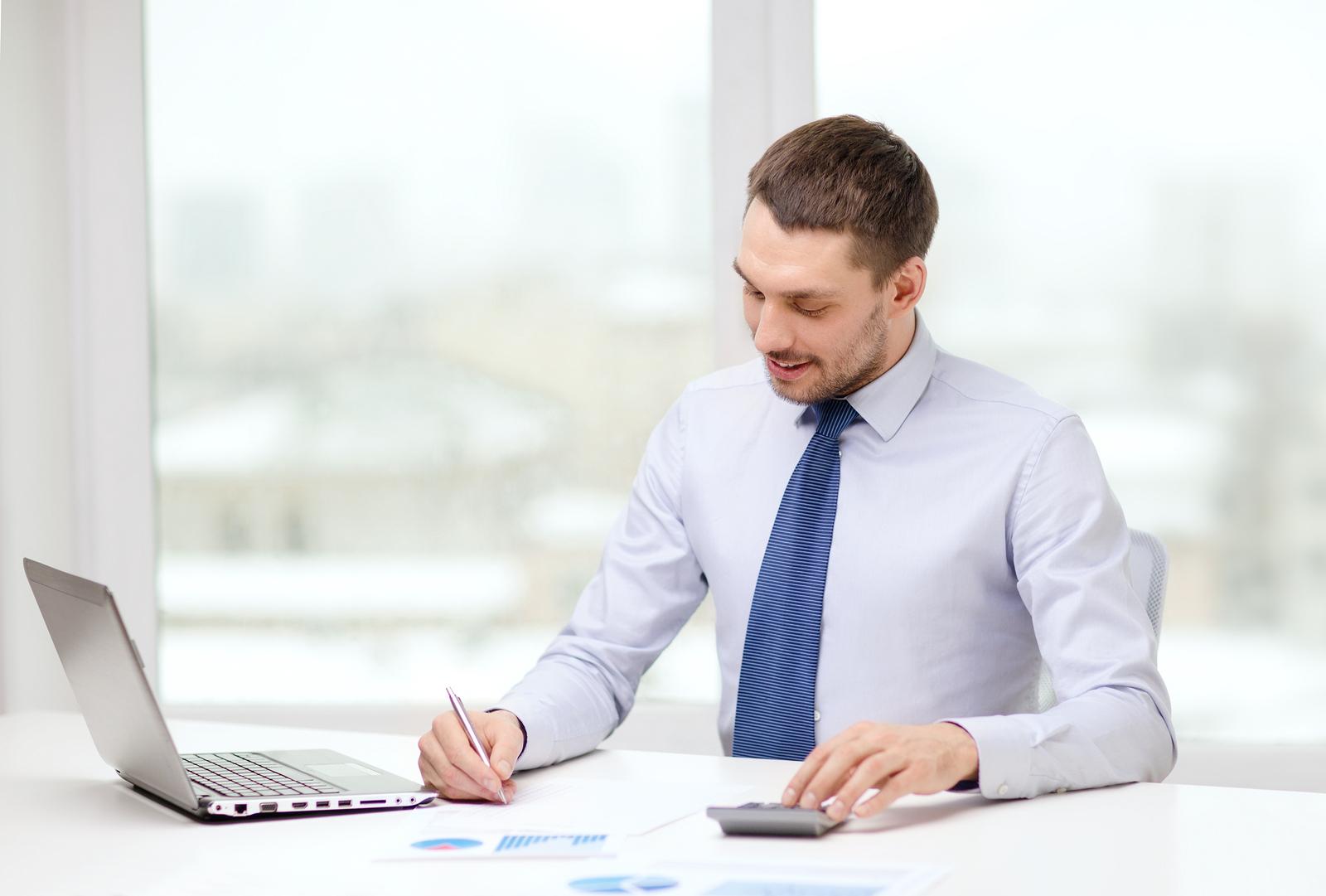 Man working while sitting at desk