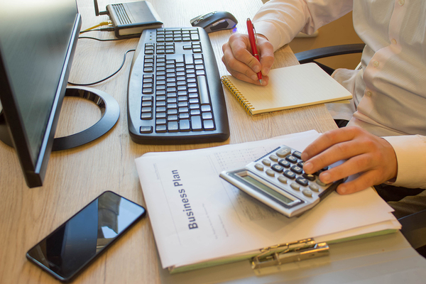 man at desk working on business planning
