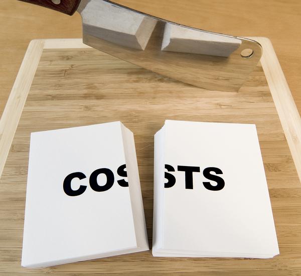 knife cutting a book that says cut